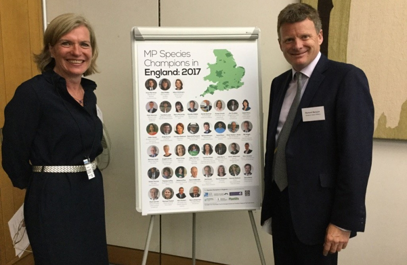 : Marian Spain, CE of Plantlife, and Richard Benyon MP with the list of MP Species Champions in England 2017.